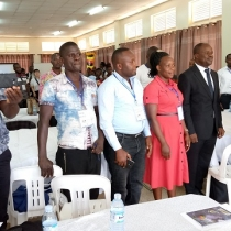 Commissioner Michael Wamibu (In suit) together with the young entrepreneurs during their training. Courtesy photo