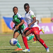 Uganda's Skipper Juliet Nalukenge aiming to shoot during the match. Courtesy photo